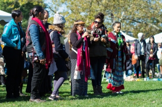 RANDALL'S ISLAND, MANHATTAN - October 10, 2016: Participants from Standing Rock share their stories at Monday's Indigenous Peoples Day Celebration. These people have been actively and courageously fighting the Daktoa Access Pipeline on the frontlines.