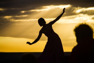 MAUI - a Luau dancer silhouetted against the setting sun