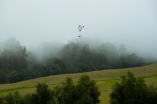 MAUI - a paraglider floats through the fog over Ali'i Lavender Farm