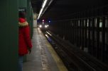 BROOKLYN - January 26, 2017: A passenger waits for an approaching 2 train at Newkirk Avenue Station in Brooklyn.