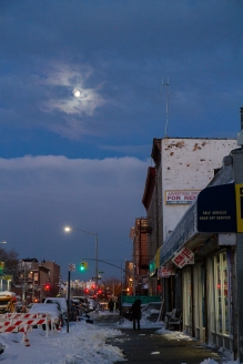 Moon rising over Avenue D after a snowy day.