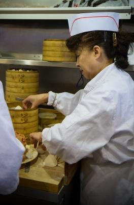 A chef makes dumplings at Nan Xiang Xiao Long Bao in Flushing, Queens