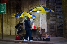 Pretzel seller underneath the Brooklyn Bridge.