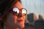Sunset on the Brooklyn Bridge reflecting in Jamie's glasses.