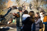 A violinist entertains a little girl at Central Park on a sunny Sunday.