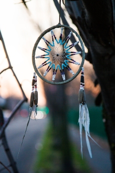 Dreamcatcher hanging outside of Holy Cross Cemetery.